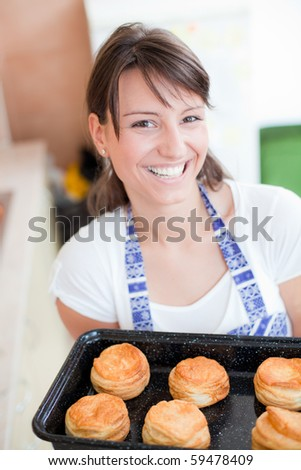 Women holding tray with delicious pastry - stock photo