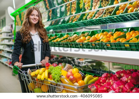 Women housewife with cart shopping in supermarket - stock photo