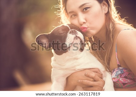 Women hugging a dog and kiss. Them playful and happiness. - stock photo