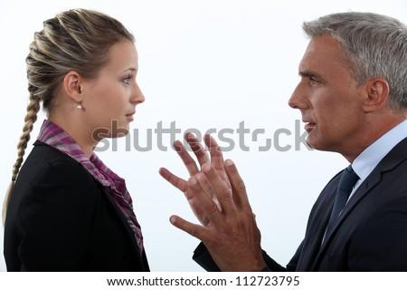 Women hypnotizing men - stock photo