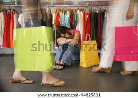 Women in clothing store - stock photo