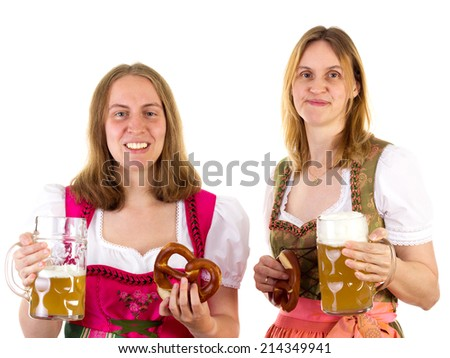Women in dirndl having fun at oktoberfest - stock photo