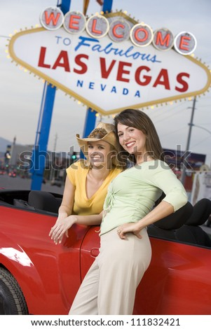 Women in front of a 'Welcome to Las Vegas' sign