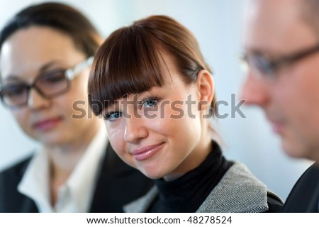 Women in glasses with girl and men in glasses - stock photo