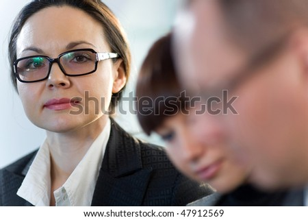 Women in glasses with nice girl and men - stock photo