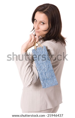 women in grey suit keeping blue present bag - stock photo