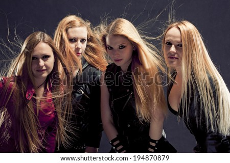 Women in leather / rock and roll band - stock photo