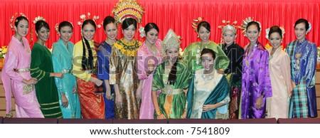 Women in Malaysian traditional dress. - stock photo