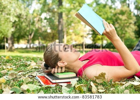 women in park concentrate on reading book - stock photo