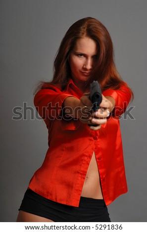 Women in red with big black gun - stock photo
