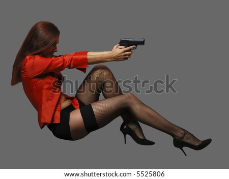 Women in red with big black gun - stock photo