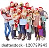 Women in Santa hat holding sign saying sale and gift box. - stock photo