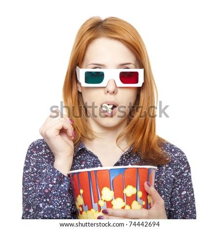 Women in stereo glasses eating popcorn. Studio shot. - stock photo