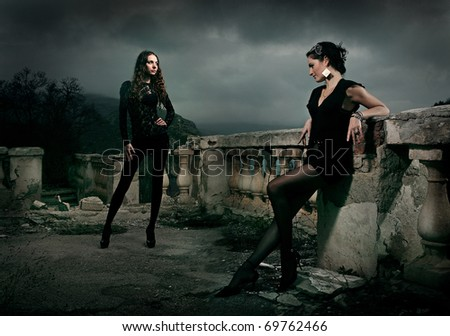 women in the old castle - stock photo