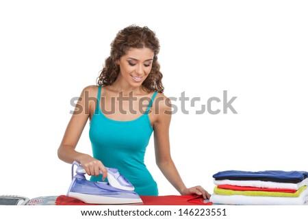 Women ironing. Beautiful young women ironing while standing isolated on white - stock photo
