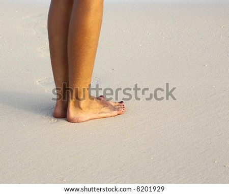 Women is on the sandy coral beach