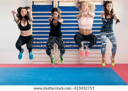 Women jumping on training - stock photo