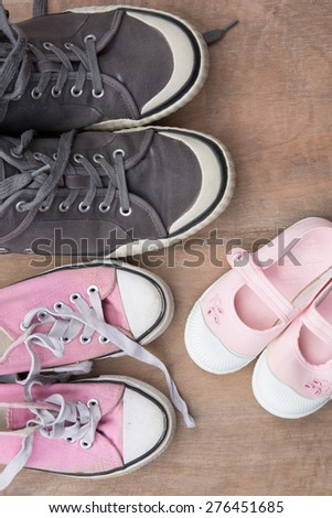 Women, kid, and men shoes , family concept - stock photo