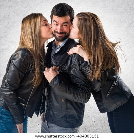 Women kissing a man - stock photo