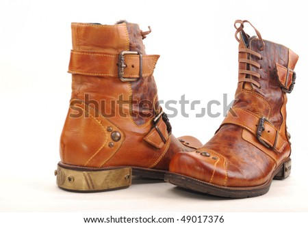 Women leather boots on a white background