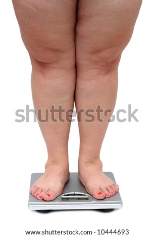 women legs with overweight standing on bathroom scales - stock photo