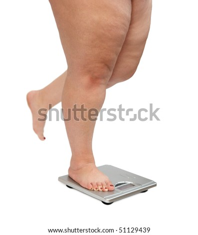 women legs with overweight standing on scales - stock photo