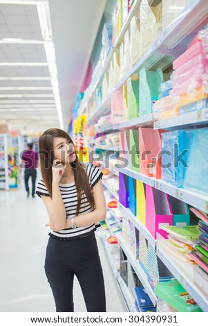 women looking at product in shelf in supermarket
