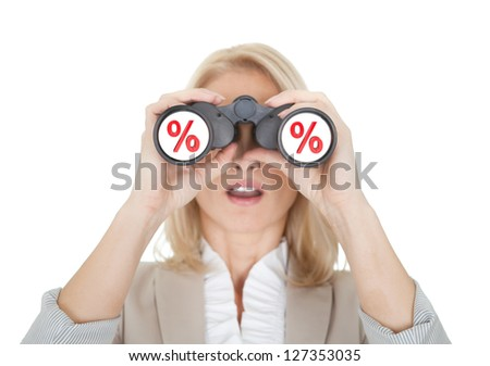 Women looking for sale through binoculars. Isolated on white - stock photo