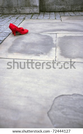 Women Luxury Red High Heel shoes on the pavement with copy space