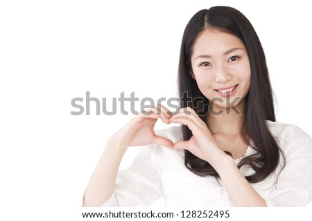 Women make a heart symbol by hand - stock photo