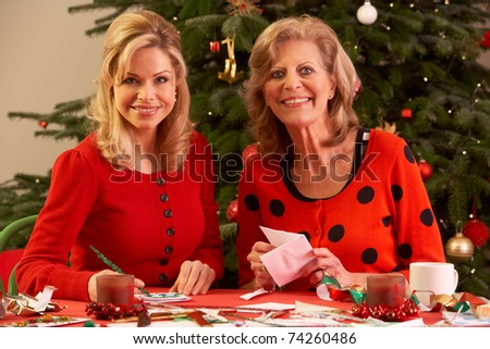 Women Making Christmas Cards At Home - stock photo