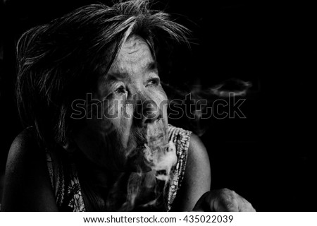Women man smoking a cigarette black and white tone