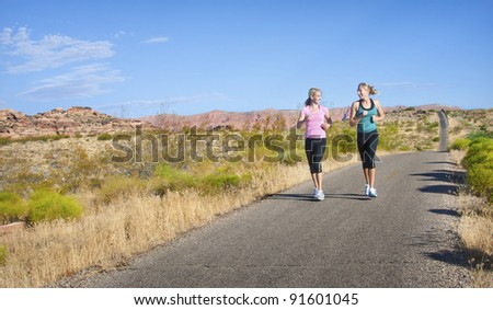 Women on a morning jog together - stock photo