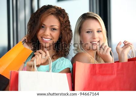 Women on a shopping spree - stock photo