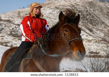 Women on horseback. Altay - stock photo
