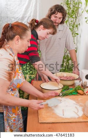 Women on kitchen do the fresh dough. - stock photo