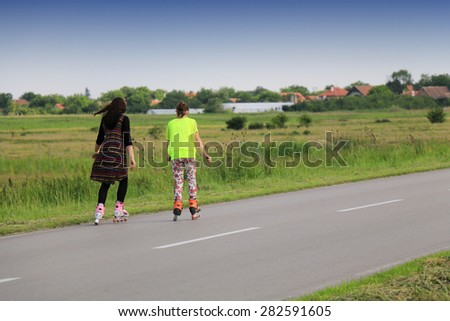 women on rollerblades - stock photo