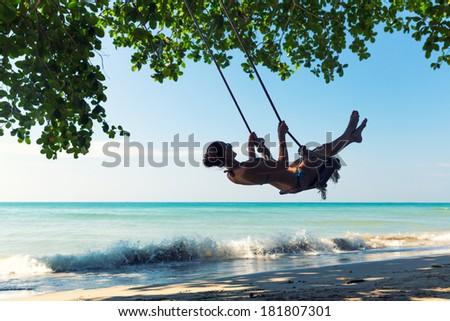 Women on swings - stock photo