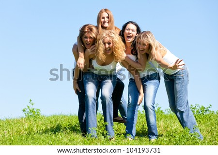 Women on the meadow - stock photo