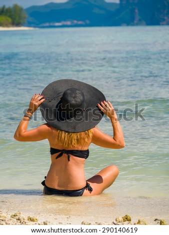 women on the tropical beach - stock photo
