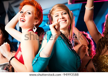 Women or models in club or disco having fun and dancing ecstatically - stock photo