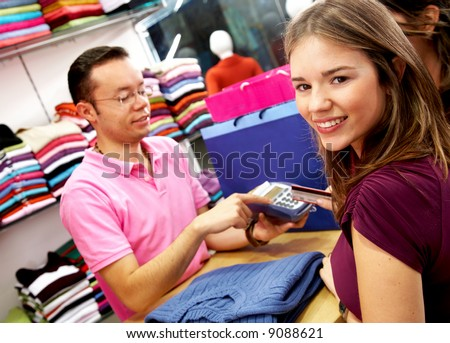women out shopping about to pay for their goods by credit card - stock photo