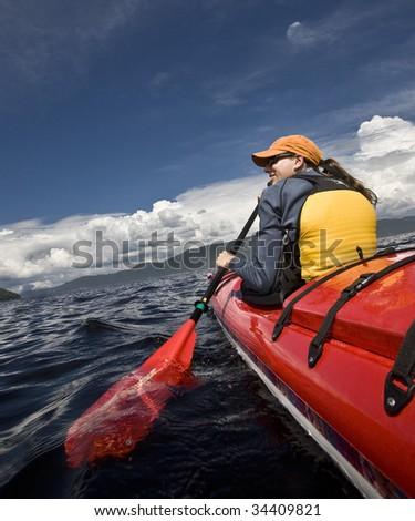 Women paddling a sea kayak - stock photo