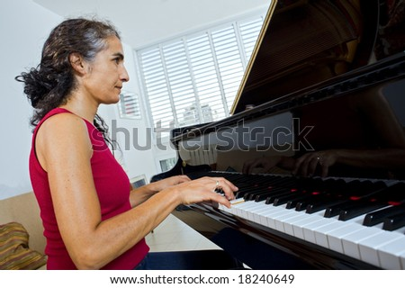 women pianist playing on a grand piano