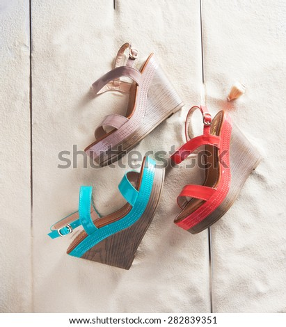 women platform shoes in sand on a deck - stock photo