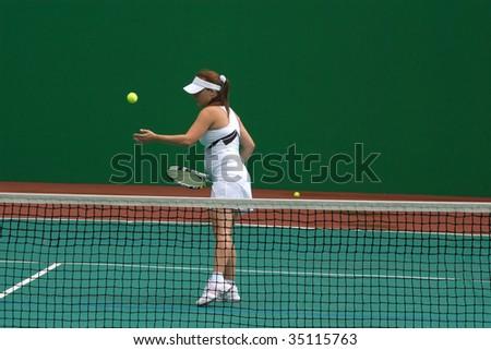 Women play tennis - stock photo
