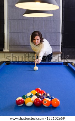 Women playing pool
