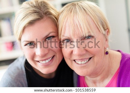 Women portrait with happy mom and daughter smiling, face to face, showing love and affection. Close up - stock photo