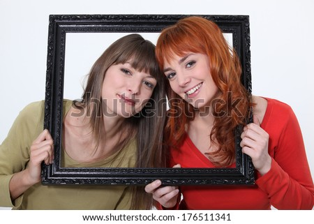 Women posed in a frame - stock photo