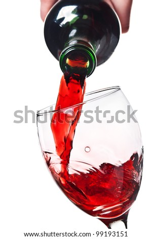 Women pouring red wine into a glass isolated on a white background - stock photo